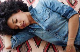 woman sleeping carpet denim
