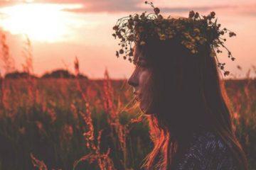 woman in field 678x381