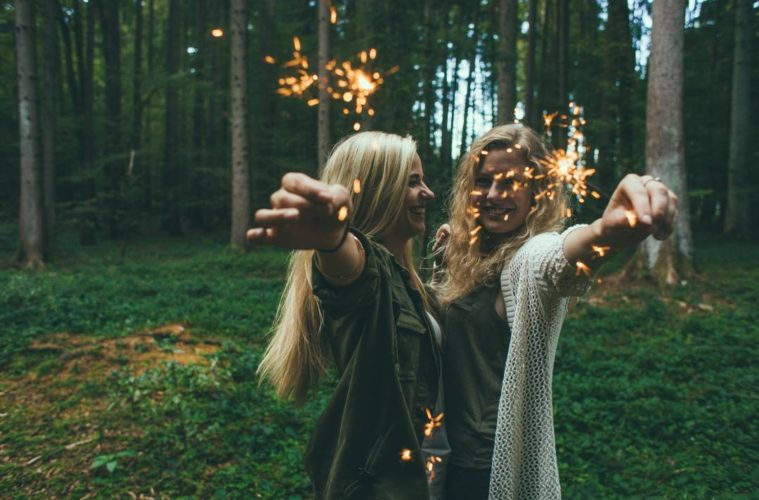 forest person people woman celebration young autumn glow pyrotechnics smiling sparkle cheerful outdoors fireworks girls happy sparklers party joyful merry screenshot 846299