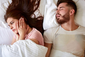 snoring husband in bed 1140x667