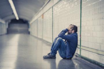 depressed man subway station